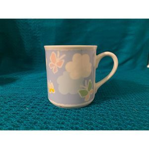 Vintage butterfly and clouds Mug